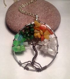 Four seasons tree of life necklace  on Etsy, £10.00