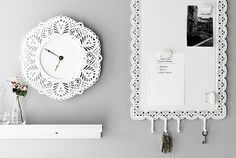 An IKEA SKURAR clock and other wall decoration accessories