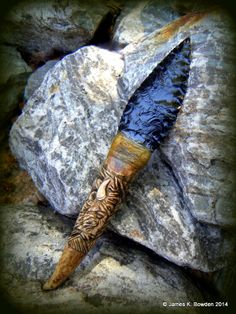 Deer Antler Handle with a carved bison by Neil Fehr, and an obsidian blade flintknapped and hafted by James K. Bowden using deer sinew and hide glue