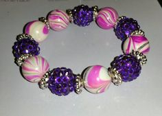 Check out this item in my Etsy shop https://www.etsy.com/listing/253546218/beaded-stretch-bracelet-purple-and-pink