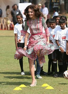 Kate followed William throwing herself around the  pitch – and even managed to jump over p...