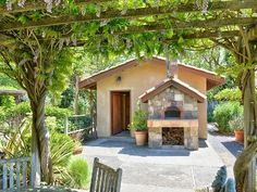 Tuscan Auberge with outside pizza oven. Cute!