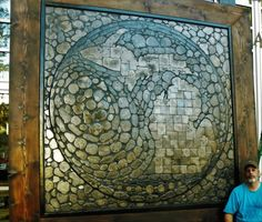 WORLDS LARGEST PETOSKEY STONE DISPLAY       Using petoskey stone and fossil, a framed two-dimensional display with a square shape that measures approximately ni
