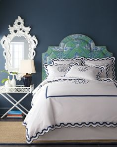 Bedding Navy walls, white quatrefoil fretwork butler's table as a nightstand, dark walnut floors, sisal rug with navy trim, green and cobalt toile upholstered headboard with nailhead trim, and fabulous Matouk linens with navy trimmed scallops and monogram. Yes yes yes.
