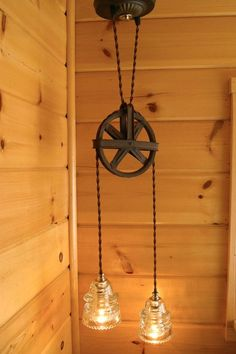 Oh my! I have to figure out a way to do this! I LOVE it! Industrial Chic Vintage Pulley & Insulator Hanging