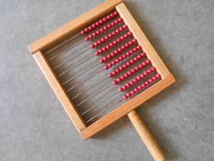 Vintage wooden abacus . . . with a handle.