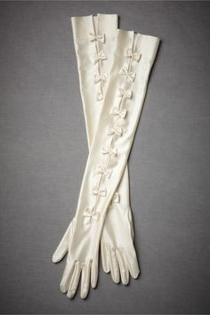i would totally consider wearing long gloves, at least for the ceremony