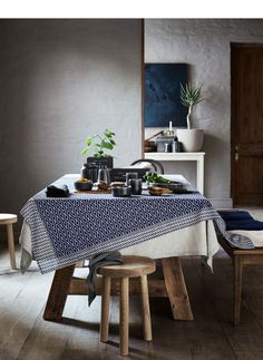 Bring both serenity and style into your home with indigo-colored cushions, blankets, rugs and kitchen towels.