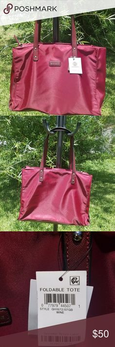 "Giani Bernini Foldable Tote - Gorgeous Wine Color! This beautiful Giani Bernini foldable tote is the perfect accessory while on the go! It is nylon with faux leather trim and 15 1/2"" wide x 11 3/4"" high x 5 5/8"" deep. There are a few very small spots on the front of the bag that I couldn't see except in direct sunlight. Giani Bernini Bags Totes"
