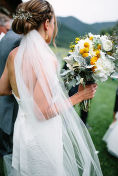 White Baby's Breath Decorated Updo | Photo: Votive Photography |