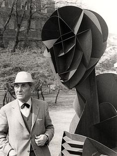 Naum Gabo with an enlarged version of his Head No. 2 sculpture produced in 1966