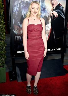 Lady Lovegood in red: Evanna Lynch cast her magic at the opening of The Wizarding World Of Harry Potter at Universal Studios Hollywood on Tuesday
