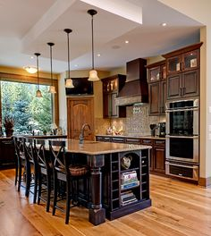 Want a window like that in my kitchen :) Dark Cabinets light floor