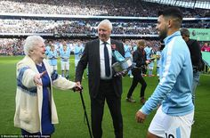 Eric Brook's daughter, Betty Cowgill, hugs City's new all time record goalscorer Aguero on...