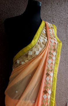PSS192 Peach saree with moti - geometrical hand -embroidery  More details: Watsapp +91-9022 617 481 or email on info@pritisahni.com