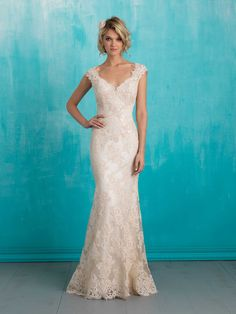 Inspired by vintage lace, this sheath backless wedding gown is both delicate and timeless. V-neck, cap sleeves.
