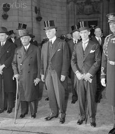 President Stenio Vincent Arrives In U.S. Original caption: 4/16/1934-Washington, DC- President Stenio Vincent of Haiti was given a warm welcome by Secretary of State Cordell Hull and a group of diplomats on his arrival in Washington, D.C. to confer with President Roosevelt. Cavalry, the Marines, and an Army band turned out for the occasion. Pictured (L-R) are: President Vincent, Secretary Hull, and Marvin McIntyre, secretary to President Roosevelt. © Bettmann/CORBIS