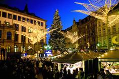 "The Wiesbaden, Germany Sternschnuppenmarkt, ""Twinkling Star Christmas Market,"" is located at the Schlossplatz between the Rathaus and the Stadtschloss."