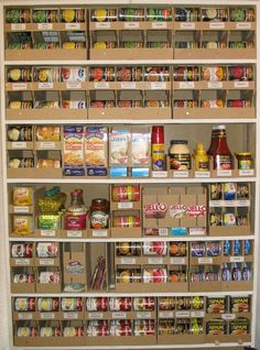 Pantry organization with rolling can chutes. WOW