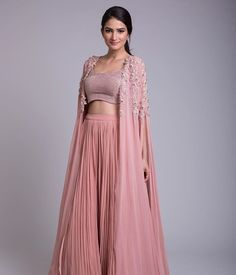 Ridhi Mehra - an exclusive capsule collection featuring fabulous jumpsuits, anarkalis & lehengas apt for exotic destination… Indian Gowns Dresses, Indian Fashion Dresses, Indian Designer Outfits, Designer Dresses, Fashion Outfits, Evening Dresses, Choli Designs, Lehenga Designs, Indian Wedding Outfits