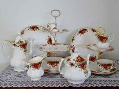 Two teapots and a coffee jug cake plates and more all for hire  at www.highteahire.co.nz