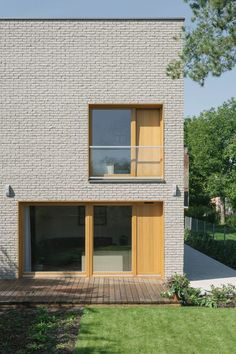 Recessed windows lined in oak interrupt the homogenous brick facades of this house in Warsaw, which local architecture studio MFRMGR designed to make the most of an awkward site. House for L occupies a compact plot in the Polish capital, but was required to accommodate a large family. MFRMGR responded by pushing the building as