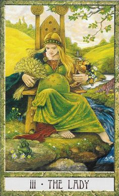 """The Druid Craft- Key 3-The Lady, card emphasizes the flow of life. Here she is both Mother Earth and Mother Venus shown by the """"Morning stars"""" on her head band. The Apple tree, is fruitful with apples, a sacred fruit of the Western Goddess images. When cut in half, one finds the image of the..."""