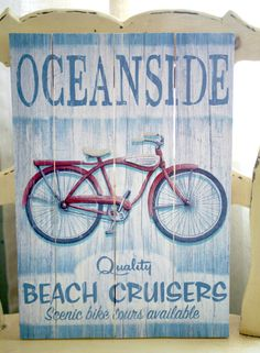 James needs one of these to hang above his bike in our dining room... even though he's upgraded from a beach cruiser to a road cycle.