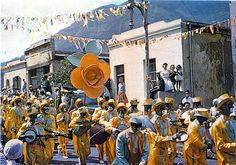 """Every year on the day of January the streets of Cape town become alive with colour and music, when the various """"troops"""" of Coons march to the centre of town.This shot was taken during the early sixties in District Six. Inner World, Cape Town, Live, Touring, South Africa, Past, Places To Visit, Street View, Backyard"""