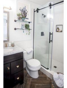 Incorporating Lots Of White And Clear Glass Helped Make The Bathroom Feel  Deceptively Large And Airy. If You Have A Small Bathroom, Take My  Designeru0027s ...