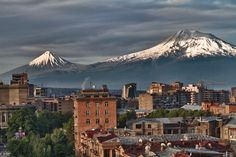 """Mount Ararat as seen from the Armenian capital Yerevan. Located in eastern Turkey, Mount Ararat stands at an elevation of 5,165 m and forms a  near-quadripoint between Turkey, Armenia, Azerbaijan and Iran. The name """"Ararat"""" derives from the biblical tradition (Genesis 8:4) linking it with the Mountains of Ararat where Noah's Ark came to rest after the great flood."""