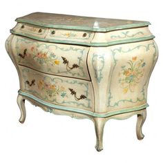 Italian Venetian painted bombe chest sold by Greenwich Living ($2,100) features a charming Venetian design painted on a white background. The chest features a lovely distressed crackle finish and fine hand-painted floral detail on a cream ground. The serpentine top rests on a narrow frieze fitted with two small drawers over two larger drawers. The drawers have oak secondaries raised on cabriole legs.