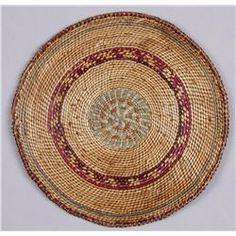 "Nootka Northwest Coast Basketry TrayMeasures 7 1/4"" diameter, in overall good condition."