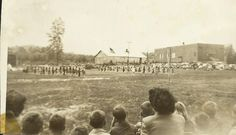 Edneyville NC Elementary School 1954 with my class - my own photo I took and the back of my teacher mean Mrs. Worley - with some of the students - it was a field day - with the famous majorette of the day leading the band.