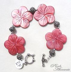 Coral/Pink Flower-Shaped Shell and Sterling Silver Plated Bracelet, 8.00 inches long.  Get this brilliant summer piece in the Pink Accents eBay boutique!