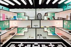 Black & White staggered shelving retail interior