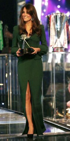 December 16, 2012 Catherine, Duchess of Cambridge made her first public appearance since the announcement of her pregnancy and subsequent stay in King Edward VII Hospital at the BBC Sports Personality of the Year Awards. To dress for the event, she turned to Alexander McQueen, the same label behind her wedding gown, for a silk hunter green floor-length gown. Just look at her pregnancy glow