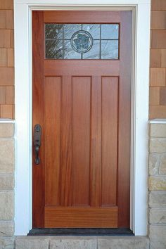 The simple elegance of this craftsman-style door is enough to add light and distinction to a boring entryway.