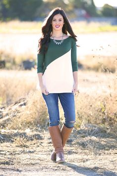 """Get ready for the fall season with the Daphne Diagonal Tunic! This 3/4 sleeve tunic features a relaxed fit body and diagonal colorblocking in several winning combinations! Pair with jeans and sneakers for a casual look or add leggings and riding boots for a more polished option!Colors Available Black/RedNavy/RedHunter Green/WhiteNavy/WhiteNavy/OrangeRed/WhiteRoyal/WhiteSizes Available Small (0-4)Medium (6-8)Large (10-12)XL (14-16)Women's SizingModel is 5'9"""" - Wearing a size Small.Materi..."""