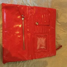 Steve Madden red leather fold over clutch Super cute Steve Madden Red Patent leather Fold Over Clutch with silver hardware and lining.  has two zipper pockets, 4 card slots with a snap closure to protect cards, and an id holder, so no need to carry a wallet with this clutch.   Used only once. Steve Madden Bags Clutches & Wristlets