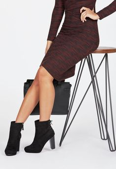 A platform faux suede bootie that is sure to sweep you away this season. She features a covered platform, lace up back detail, and faux stacked heel.  ...