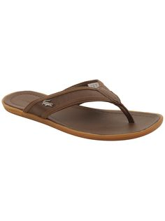 048cd244c025 Kick up some sand in these must-have summer sandals by Lacoste.