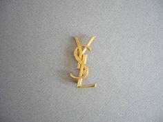 Vintage Yves Saint Laurent YSL Brooch 1980's by xDIVINEx on Etsy https://www.etsy.com/listing/160099829/vintage-yves-saint-laurent-ysl-brooch
