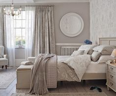 Pretty papered focal wall and beautiful muted textiles