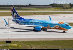 WestJet Airlines (CA) Boeing 737-8CT C-GWSV aircraft, painted in ''Walt Disney World-Frozen'' special colors, rolling at Canada, Alberta, YYC Calgary Int'l Airport. 29/06/2017. (Frozen=a 2013 American 3D computer-animated musical fantasy film produced by Walt Disney Animation Studios).