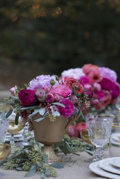 Holiday table setting inspirations with elegant dishes, gold glasses and gorgeous diy flower centerpieces.