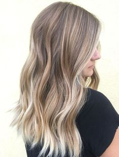 Trendy Long Layered Hairstyles with Blonde Highlights