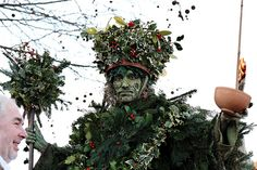 Twelfth Night festivities on the south bank of the Thames near the Globe Theatre. The Lions Part theatre company lead the proceedings, which include the arrival of the Holly Man by boat, wassailing, a mummers play, and a procession along the Thames.