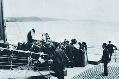 A U.S. doctor inspects passenger's eyes aboard the Titanic. Taken in 1912.