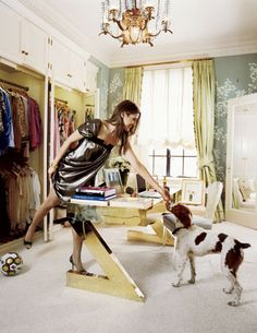 A peek at Aerin Lauder's wardrobe as she gives her dog a treat over her vintage Gabriella Crespi desk (3 of 3) #closet #dressing_room #home_office